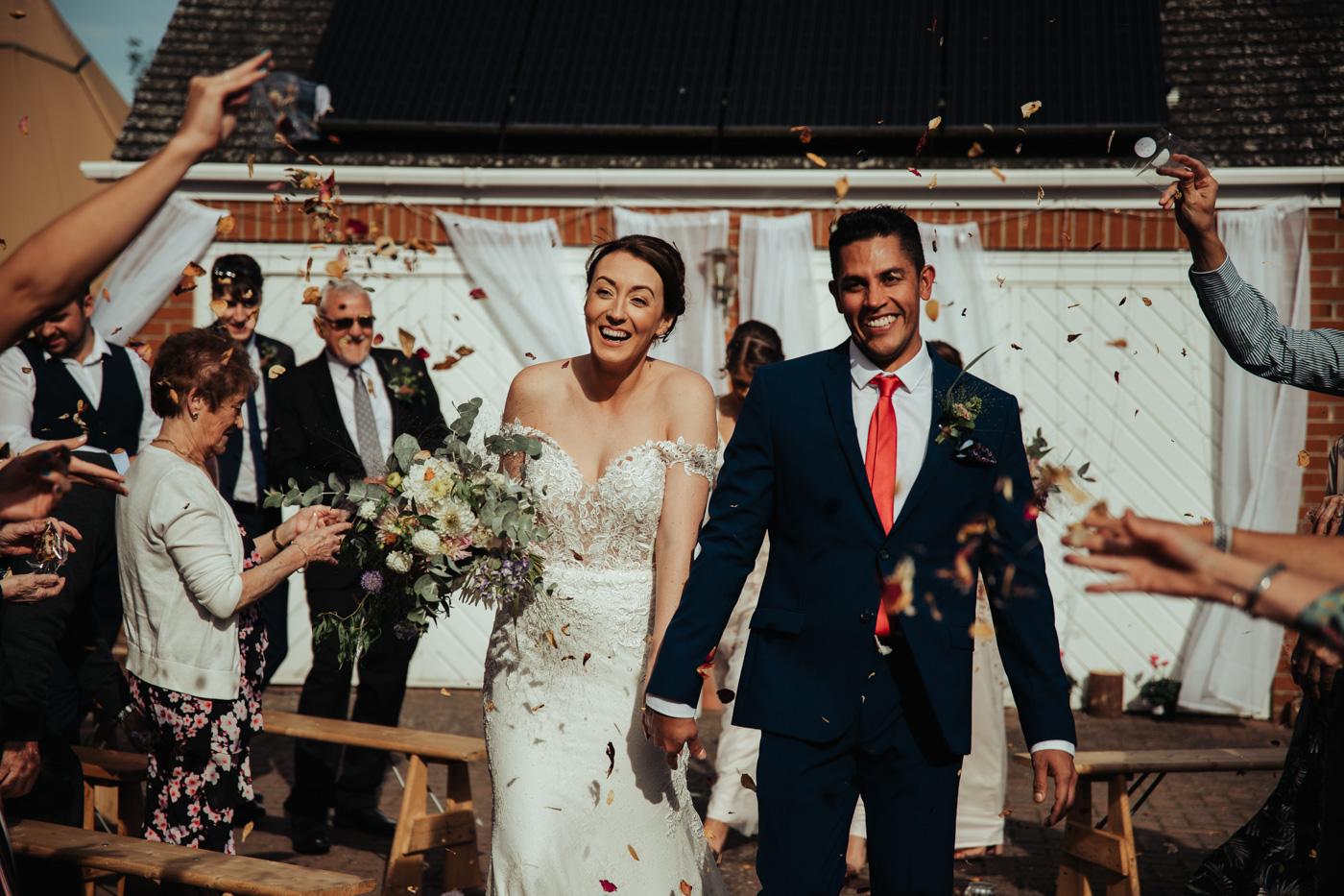 Garden wedding walking down the aisle