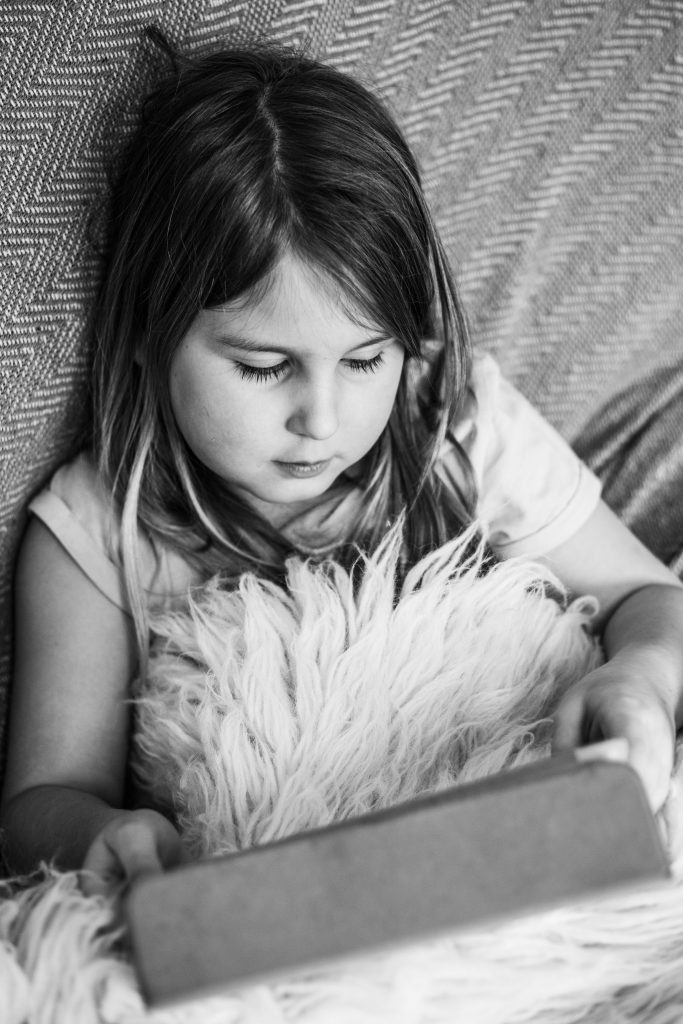 Girl watching an online lesson on an ipad